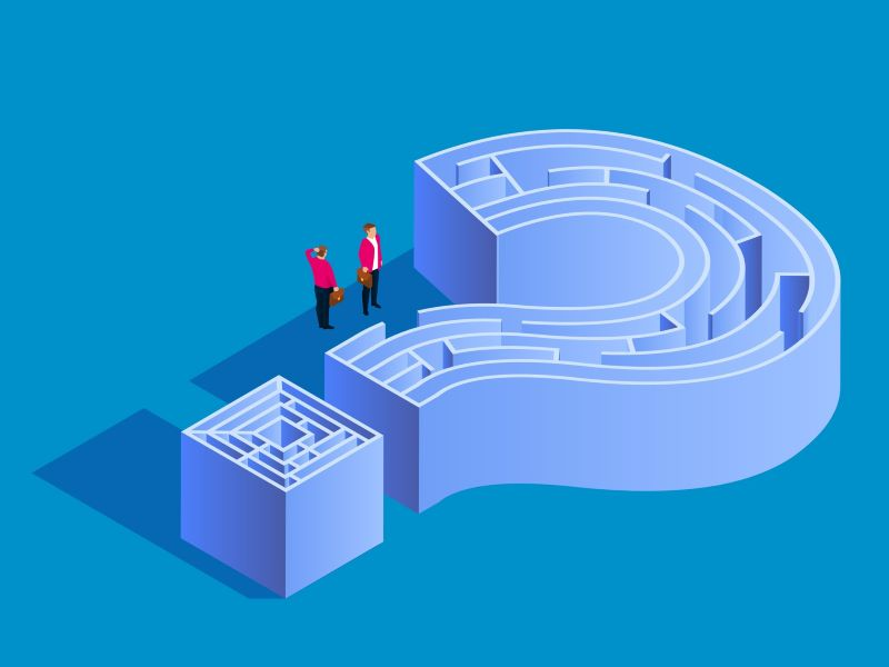 Two business people navigating through a maze shaped as a question mark